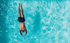 Oklahoma City has dozens of pools for residents to enjoy. Here, a man swims in an Oklahoma pool.