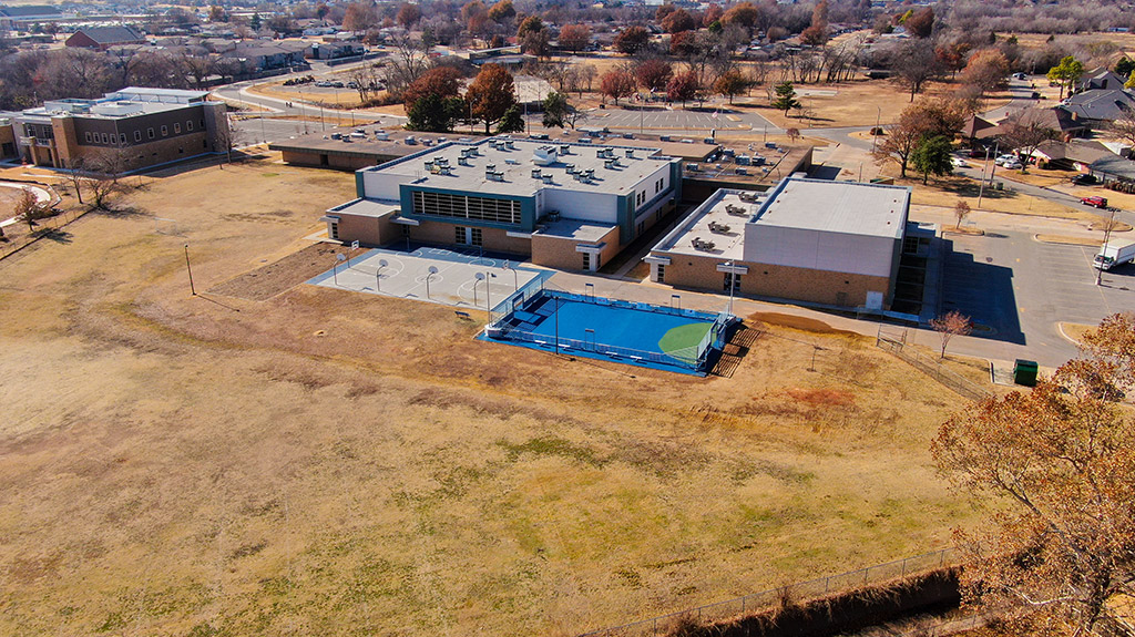 OKCPS Southeast Middle School with new basketball and futsal courts during the first phase of construction by Fields & Futures
