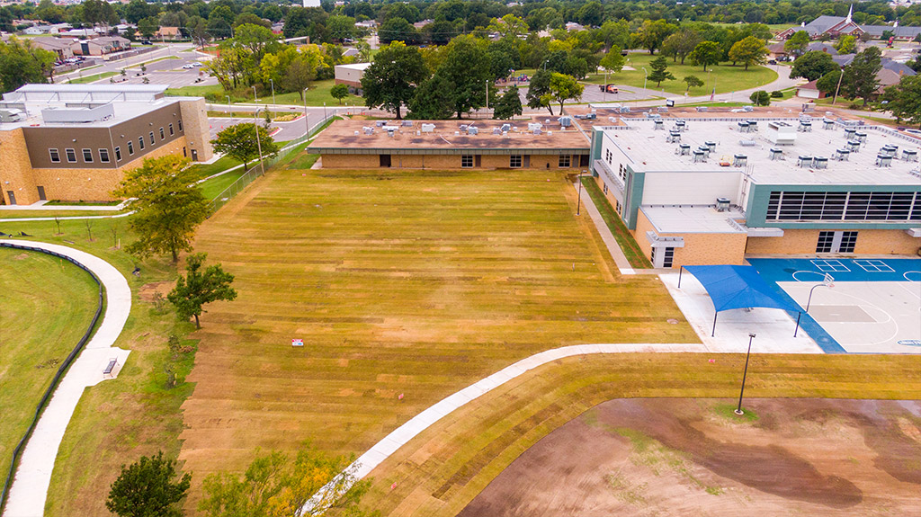 OKCPS Southeast Middle School with new sod on athletic field during field construction by Fields & Futures