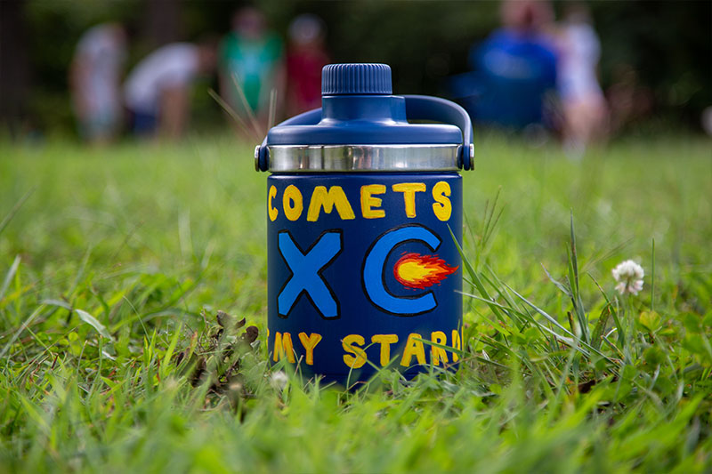 Water jug painted with Comets XC logo