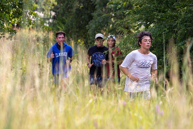 Cross-country runners from Classen SAS at Northeast High School running on a natural terrain course in Oklahoma City