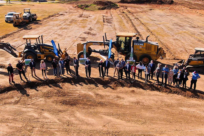 Oklahoma City Mayor David Holt and Tim McLauglin surrounded by community leaders during the groundbreaking ceremony Southern Oaks Park.