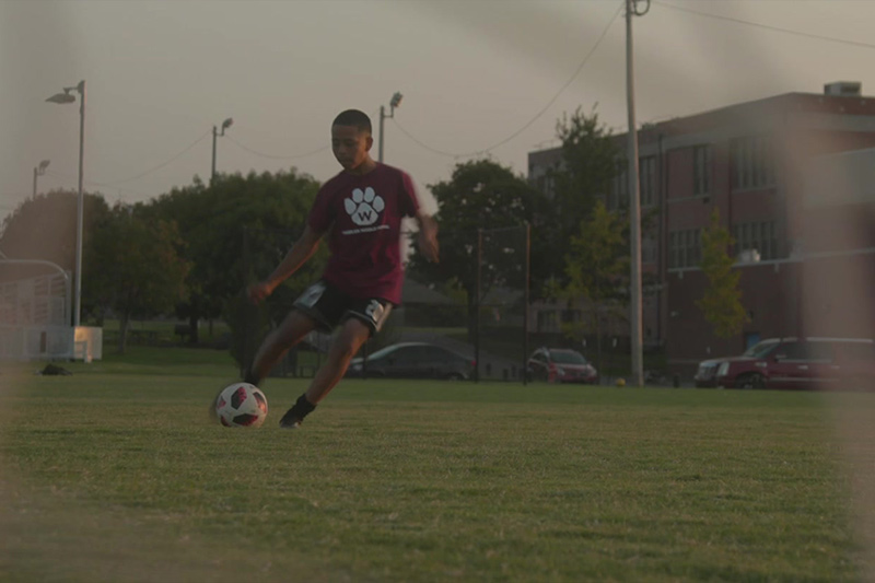 An OKCPS student-athlete playing soccer in the Fields & Futures Why We Care Campaign Video