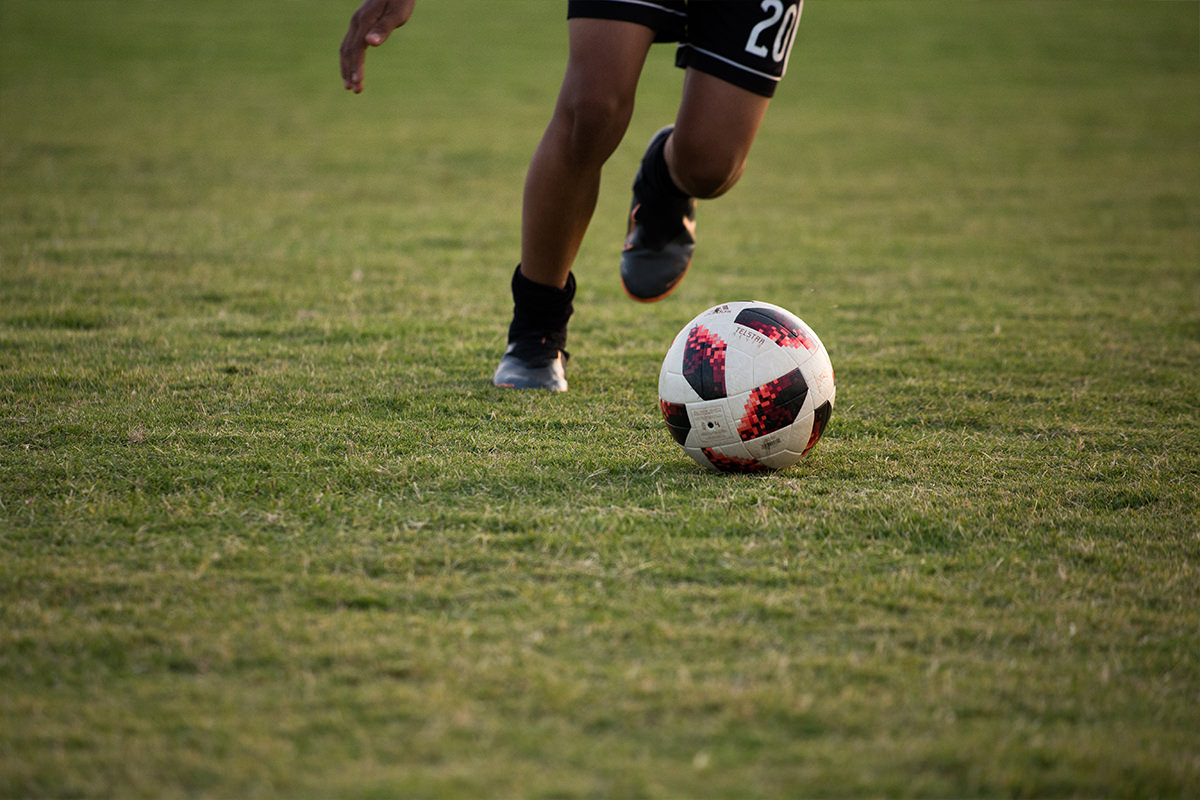Why-We-Care-Students-Andres-Quinonez-kicking-soccer-ball