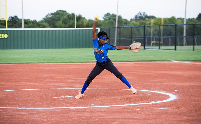 Classen SAS High School softball player Symone Talley pitching on a softball field built by Fields & Futures for Oklahoma City Public Schools