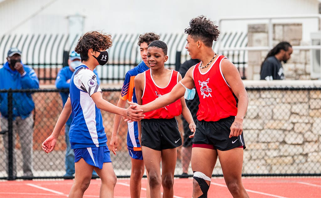 Fields & Futures All-City Track Meet Blog middle school athletes from different schools congratulating one another after a race