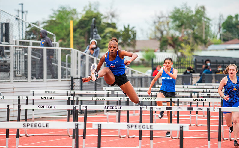 Fields & Futures All-City Track Meet blog image of female athlete from John Marshall competing in hurdles