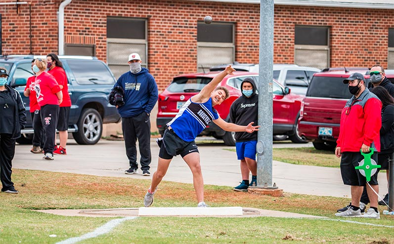 Fields & Futures All-City Track Meet Blog male middle school athlete throwing the shot put