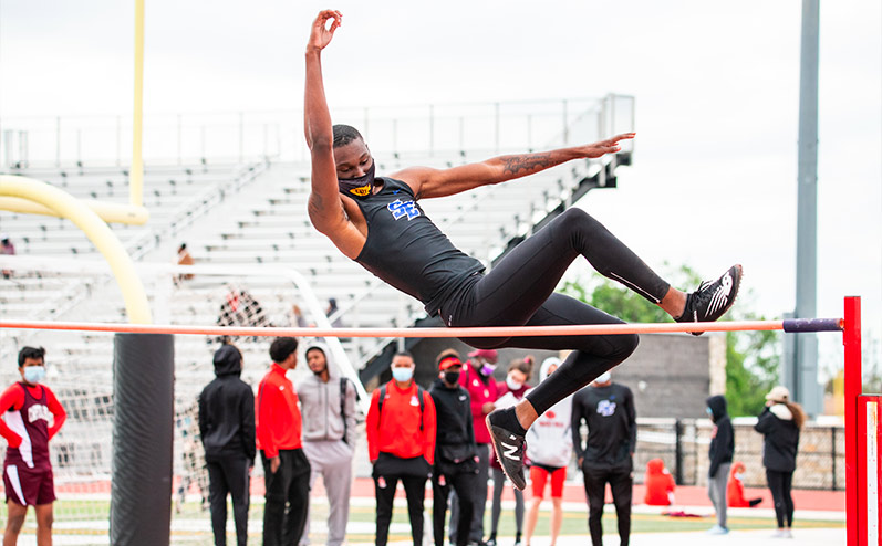Fields & Futures All-City Track Meet Blog male high school athlete competing in the high jump