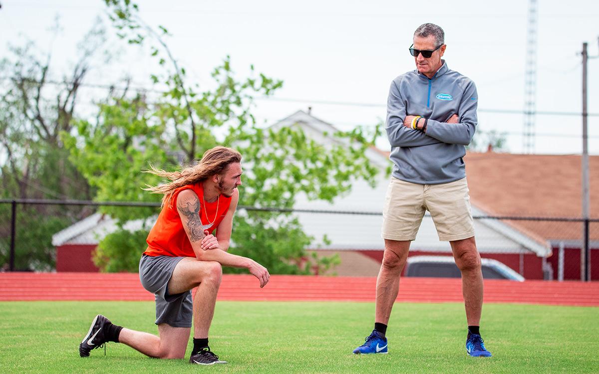 David Crynes talking with OKCPS student-athlete