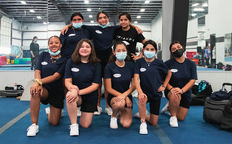 Fields & Futures blog 2021 OKCPS Cheer Clinic Wrap-Up story image of cheerleading team taking a team picture